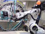 Kuka robot feeds tooling into radial braiding machine